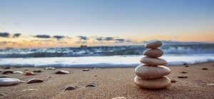 Stones balance on beach sunrise shot. Stock image